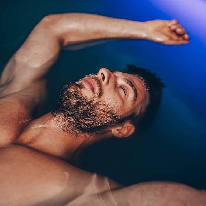 man floating in deprivation chamber