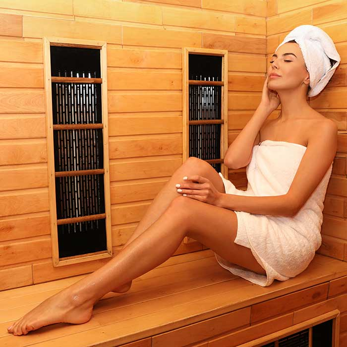woman in infrared sauna room